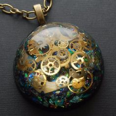 STEAMPUNK OPAL EFFECT NECKLACE PENDANT GEARS COGS WATCH PARTS IN RESIN HAND MADE