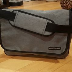 """American Crew Laptop Bag American Crew Laptop Bag. Grey with black trim and adjustable strap. 14"""" x 10"""" x 3 1/2"""". NWOT American crew Bags Backpacks"""