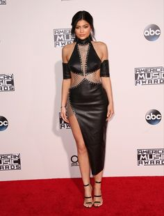 Click through Kylie Jenner's best street style moments | Black Leather Cutout Dress with High Slit