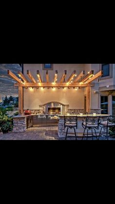 Outdoir kitchen, Pergola & Globe string lights... beautiful!