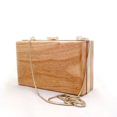 Hey, Santa...  (wood clutch available at http://tbistore.bigcartel.com/ for $35)