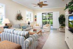 Upgrades including crown molding, plantation shutters, chair rail, large tile on diagonal, French doors, ample walk-in closets, screened lanai, patio, ceiling fans and lighting and window coverings.