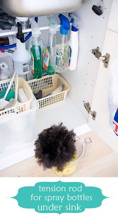 Hang cleaners from tension rod under sink