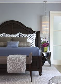 An elegant and fun master bedroom - I like the blue and gray bed linens