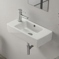 modern, sleek self-rimming or wall mounted bathroom sink. Sink includes one faucet hole on the left side of the sink and an overflow. This beautiful, space saving bathroom sink is made of high-quality white ceramic. Sink is designed by luxury and well Bathroom Layout, Bathroom Colors, Bathroom Interior Design, Bathroom Ideas, Bathroom Makeovers, Bathroom Organization, Remodel Bathroom, Bathroom Remodeling, Bathroom Storage