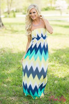The color combination on our Live Your Life maxi couldn't be better! It features a chevron print in yellow, blue, teal, and white!