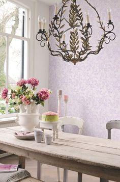 Light Oak Feast Table | Monochrome Purple Paisley Walls | Gold Leaf Chandelier | White Ceramic Decor