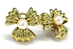 Ladies 14kt  yellow gold pearl earrings. Set in earrings are 2 round pearls approximately 7.25mm round. Earrings weigh approximately 21.51 grams of 14kt yellow gold.