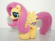 This little Fluttershy is 3 inches tall, crocheted with embroidery floss. Her eyes are crocheted and then hand-painted while her cutie mark is hand-painted on both sides. To give her a more realistic pony look, her hair is needle-felted with corriedale wool. Fluttershy is filled with pellets to weigh her down, allowing her to stand on her own. She is also stuffed with poly-fil to give her a soft plush feel..