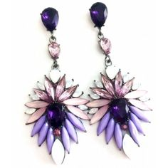 Add these statement Amra earrings to any look for a touch of glam!