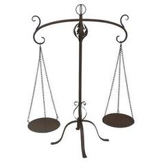 """Metal scale with scrolling details.  Product: ScaleConstruction Material: MetalColor: BrownDimensions: 33.75"""" H x 27"""" W x 17.25"""" D"""