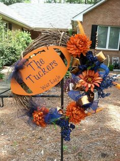 Now I like this Football wreath, except that its Auburn (YACK) - but super easy to make for BAMA!!! (also note this will be a DIY before the weekend) brandank