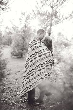 we love the idea of cozying up in a blanket for some cute engagements by MOONbelle Photography http://moonbellephotography.com/