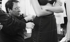 Alaia Azzedine- Born in Tunisia. He studied at Ecole des Beaux Arts in Tunis. In Paris he worked for DIOR, LAROCHE, & MUGLER until the late 1970's when he launched his own collection. Alia's early designs concentrated on body-hugging, curvaceous forms in soft glove leather, jersey, & silk. His first show was held 1982 at NY department store Bergdorf Goodman & featured a modern HOUR GLASS look. Famous for his LITTLE BLACK DRESS, swatched cashmere outfits, & figure-hugging knitwear.