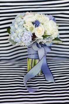 Classic & Elegant Bridal Bouquet Featuring Light Blue Hydrangea, White Jumbo Hydrangea, White Scabiosa Flowers, White Ranunculus, Ivory Roses, Blue Grape Hyacinth, Pastel Blue Hyacinth, & Dusty Miller Hand Tied Together With A Navy & White Striped Ribbon~~~~