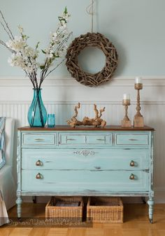 ocean breeze blue chalk paint with distressing and a dark wax, natural wood refinished top