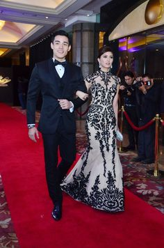 """Ikaw Lamang"" star Kim Chiu in a backless Patricia Santos gown with her on-screen partner, actor Xian Lim at the 8th Star Magic Ball. Photo by Nimfa Chua, ABS-CBNnews.com"