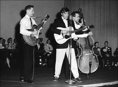 Opening act: Scotty Moore, Elvis Presley, and Bill Black perform at Messick High School Auditorium in Memphis, TN in the first week of  February 1955. Photo © EPE, Inc. See more: http://www.scottymoore.net/messick.html