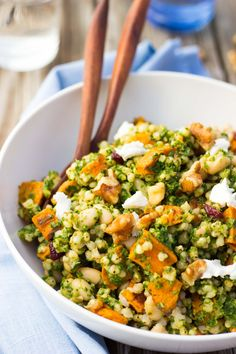 The perfect filling fall salad filled with whole grains and vegetables! Sorghum, Sweet Potato & White Bean Salad with Kale Pesto www.shelikesfood.com