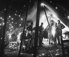 In a shrapnel-riddled tent of a beachhead hospital where five men were killed and eight were wounded by a German shell.