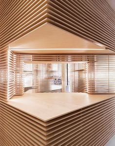 the store by jordana maisie uses CNC technology to carved out the display spaces tfrom birch plywood to form the dynamic retail space.