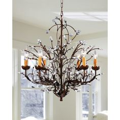 Made with antiqued bronze and sparkling crystals, this vintage-look chandelier offers old-world elegance. Featuring six 60-watt lights, it is equipped with a 39.5-inch chain for superb adjustability. This splendid chandelier is certain to turn heads.