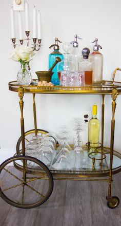 I want a tea cart so bad. Not necessarily for a bar. Bar Cart Styling, Bar Cart Decor, Bar Antique, Antique Tea Cart, Bar Trolley, Genevieve Gorder, Vintage Bar Carts, Drink Cart, Drink Table