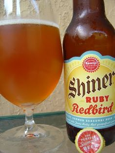 Shiner Ruby Redbird  Made at the Spoetzl Brewery in Shiner Tx..Home Of Shiner Bock.  This seasonal beer is made with Texas Ruby Red Grapefruit and Ginger  WOW!!!! Not your average run of the mill beer ..Great Change