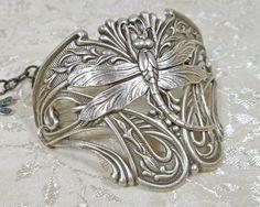 Love this!!! Art Nouveau Dragonfly Bracelet Large Half Cuff. $24.00, via Etsy.