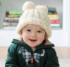 Beginner knitting pattern for this adorable baby hat with double pom poms!