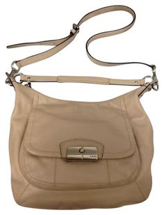 Coach Large Kristin Leather White Creamy Crossbody Hobo Bag. Hobo bags are hot this season! The Coach Large Kristin Leather White Creamy Crossbody Hobo Bag is a top 10 member favorite on Tradesy. Get yours before they're sold out!