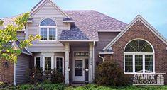 Custom and colonial internal grids dress up casement and half circle windows. #homeimprovement #homedesign