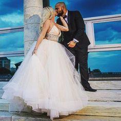 Kisses under the blue sky 💙 @notoriouskmi #love #wedding #tiedtheknotinlazaro #family #style3600 purchased at @kleinfeldbridal #jlmcouture #aisleperfect #theknot #weddingday #lazarobridal #kleinfeld