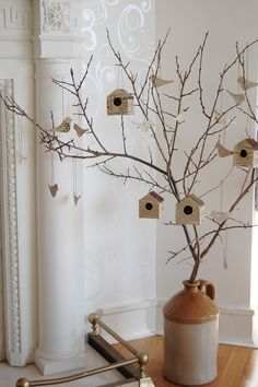 Birds and birdhouses cut out of newspapers or books and hung on a small tree. Super cute idea for a bedroom