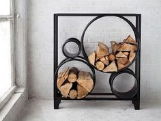 This unique wood rack has been created by the Belgian designer Luc Vincent. It is made of black metal. Outdoor Firewood Rack, Firewood Storage, Cadre Photo Design, Log Holder, Interior Architecture, Interior Design, Traditional Fireplace, Tiny House Cabin, Decoration