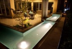 Asian courtyard with modern water feature