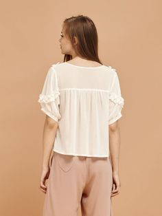 7439e2fcaeae White chiffon top with ruffle trim bib and sleeves Fabric Composition: 50% Polyester  50