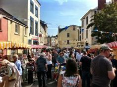 Wiveliscombe Festival Street Market. Great food, beer in the Jubilee Gardens and look out for the wheelbarrow floats.