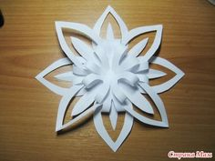 christmas craft ideas:  paper snowflake flower tutorial.  We have done a similar project even with children.  They love it, and the decorations are always fabulous