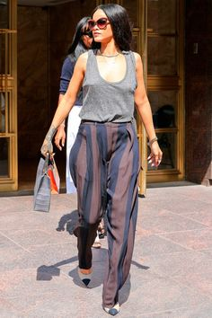 Rihanna stays a step ahead of the fash pack in her statement striped strides; a must have for Spring 2015...