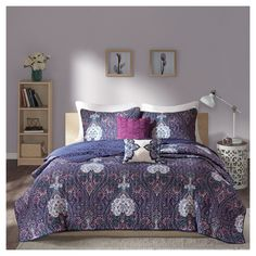 The Carmen Coverlet Set updates your bedroom with a rich, bohemian design. The deep background features an intricate paisley and floral motif with hints of vibrant colors. Two decorative pillows add a finished look to this collection with fabric manipulation and coordinating embroidery.