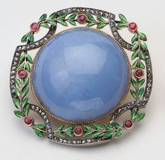 A brooch from the Royal Collection. Made by Faberge, and acquired by Queen Alexandra. There were replicas made and offered by the Metropolitan Museum of Art some years ago. Of course I bought the damn thing...