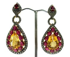 Superb Pair Of Earring By Gemvanity Having Citrine As Center Piece With Natural Ruby & Diamonds To Make A Wonderful Pair. See More @ https://www.facebook.com/Gemvanity