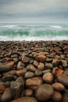 stones on shore~ reminds me of the beaches near Stonehaven in Scotland
