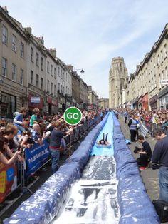Luke Jerram transforms Bristol's Park Street into a Giant 95 meters Water Slide