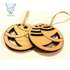 Charming in its simplicity, wooden Christmas tree ornaments. Openwork wooden balls by Strawberry.