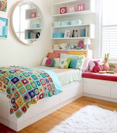 Continuous shelving makes this space saving idea look part of the bed headboard