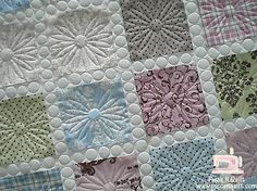 love this quilting, takes a simple quilt and makes it special