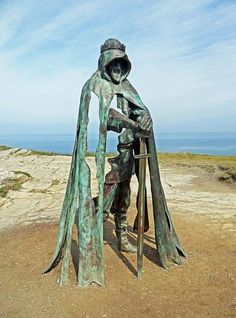 8ft statue of King Arthur on the Tintagel cliffs  Created by Rubin Eynon