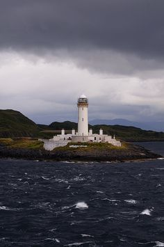 Lismore lighthouse, Firth of Lorne, Scotland. Lismore is situated on Eilean Musdile in the Firth of Lorne at the entrance to Loc...